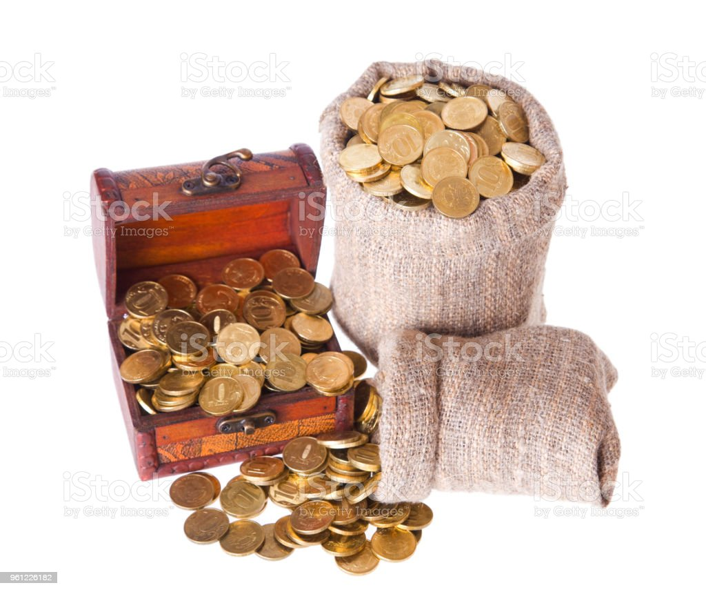 Wooden chest and two bags filled with coins stock photo