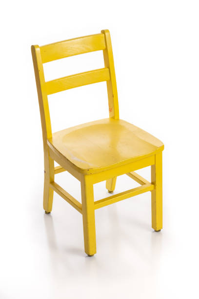 Wooden Child Chair Painted Yellow Wooden child chair painted yellow isolated on a white background. chair stock pictures, royalty-free photos & images