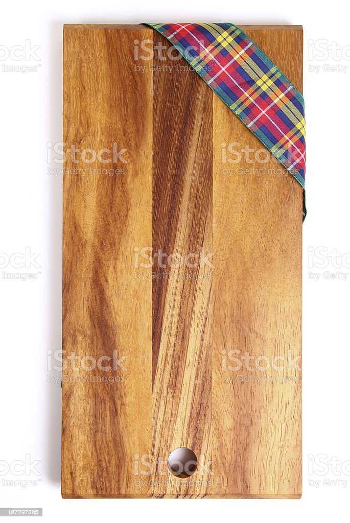 Wooden chopping board on plain background royalty-free stock photo