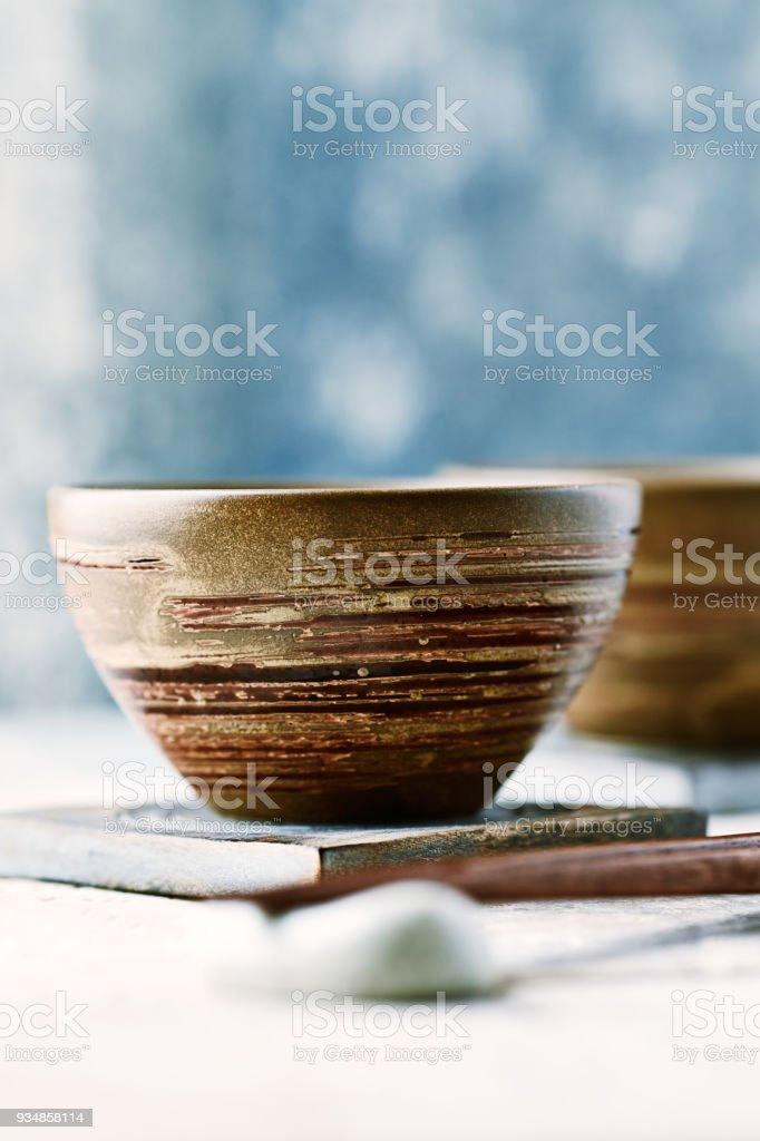 Wooden Chopsticks and ceramic Bowls stock photo