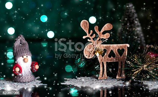 istock wooden Christmas toy, a deer, on a dark, snowy background 870867066