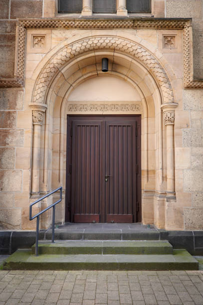 Wooden church door and arc stock photo