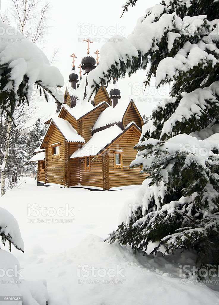wooden church on a snowy meadow royalty-free stock photo