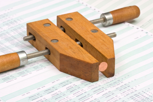 Wooden Clamp Pinching A Penny Stock Photo - Download Image Now