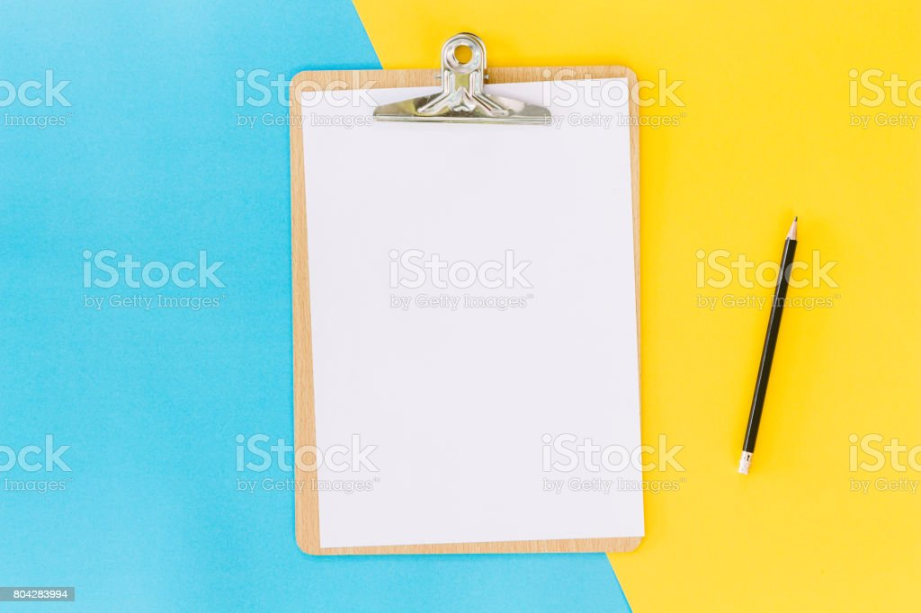 Wooden clipboard on table stock photo