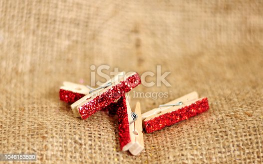 istock Wooden Clips for pinning photos and more 1046153530