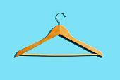 istock Wooden clothe hanger on blue background 1327438272