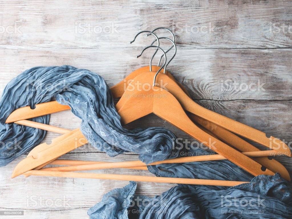 Wooden clothes hangers. What to wear stock photo