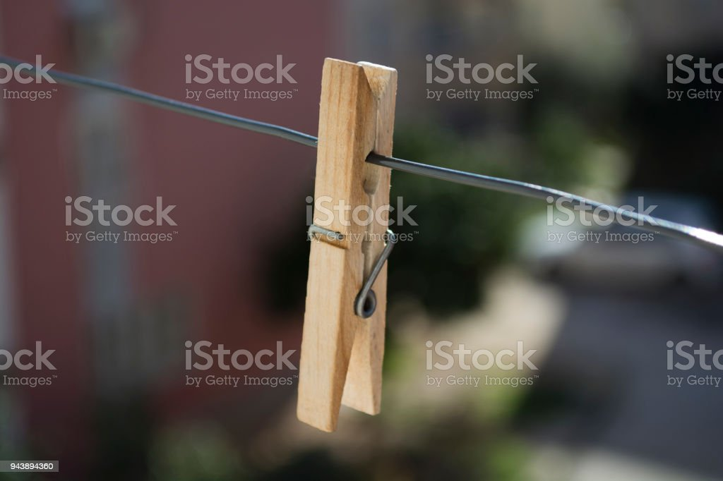 Wooden Clothes Pin on Clothes Line stock photo