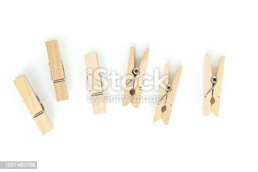 wooden clothes pin on white background.