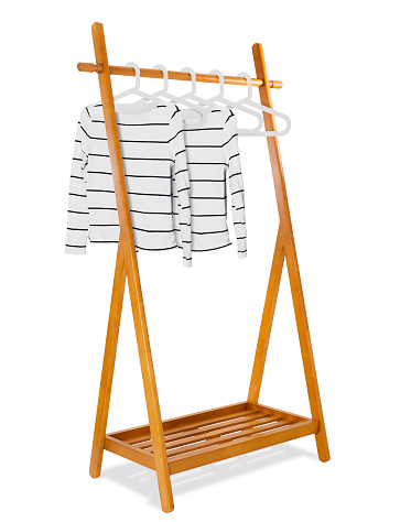 Wooden clothes rack with white fashion woman sweater on clothes hanger, Fashion and Furniture  concept, Realistic and isolated on white background.
