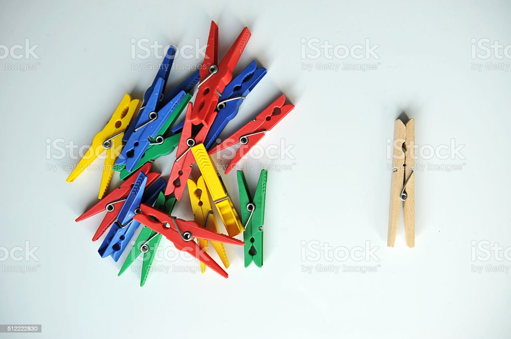 wooden clothespin surrounded by color stock photo