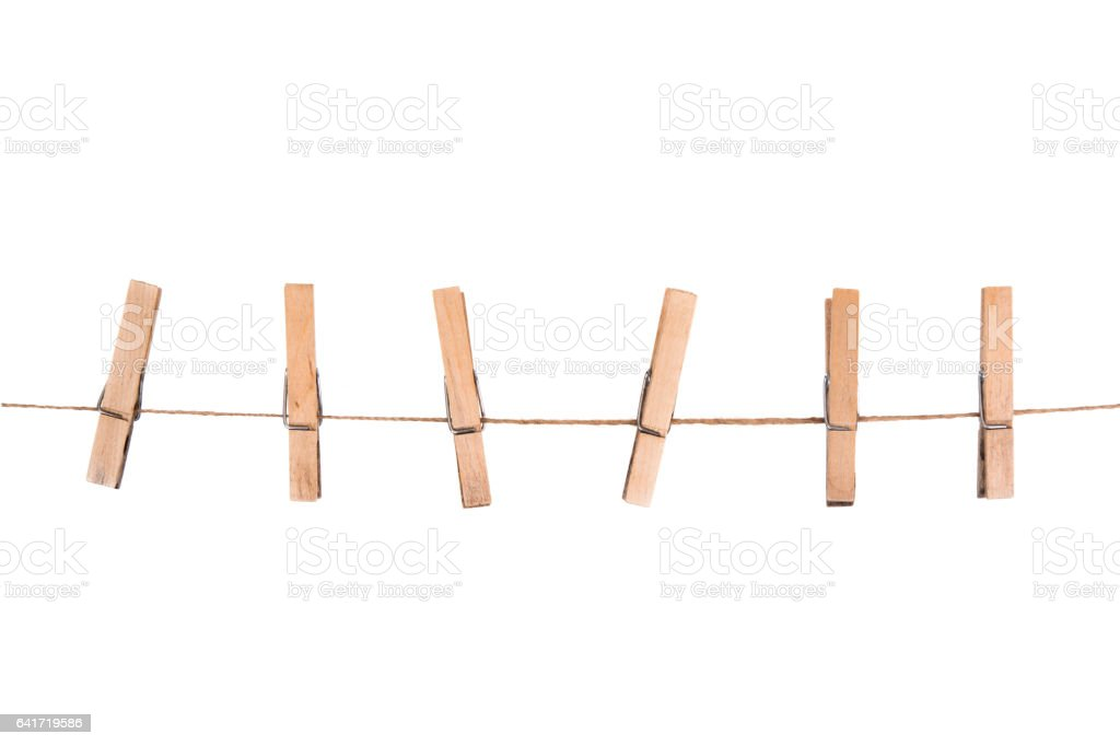 wooden clothespins on a rope stock photo