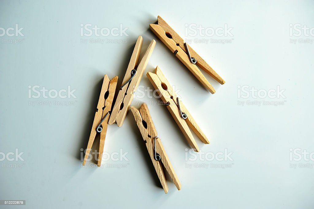 wooden clothespins on the white background stock photo