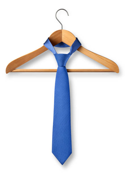 Wooden coat hanger with tie on white background stock photo