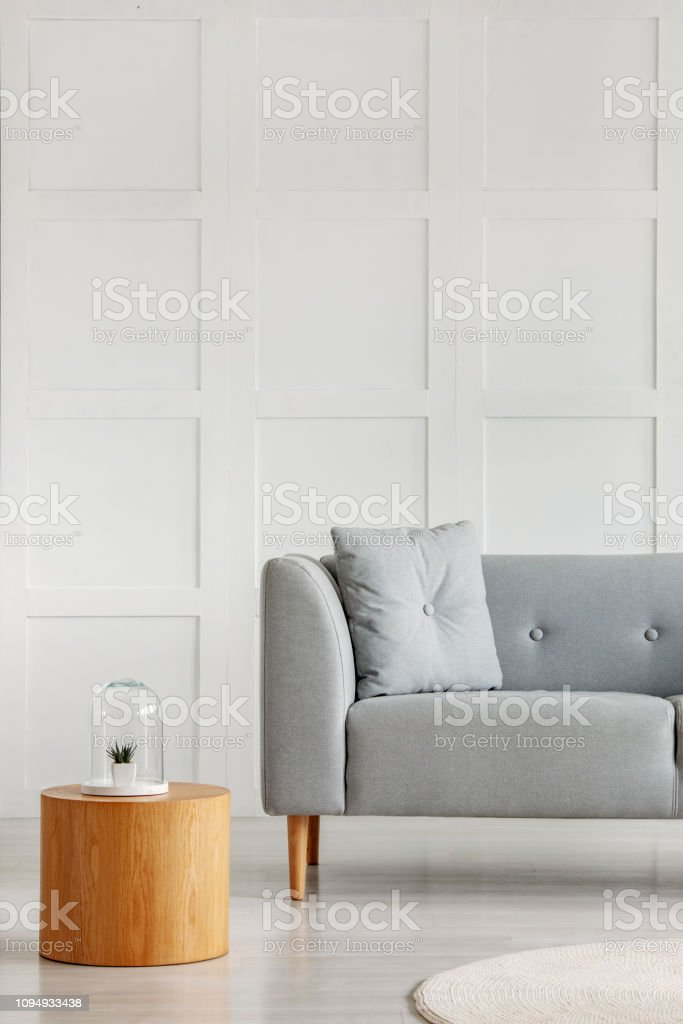 Wooden Coffee Table Next To Grey Couch With Pillow In White