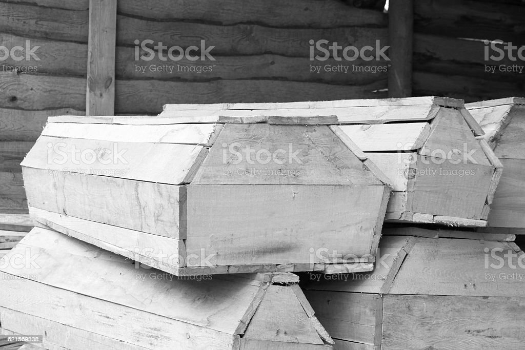 Wooden coffins of various sizes / black and white photo stock photo