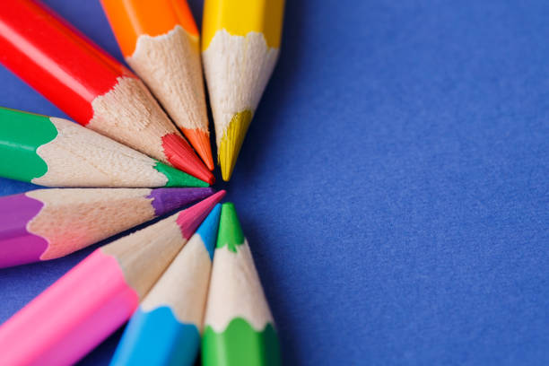 wooden colored pencils, on blue background, creative concept - coloured pencil stock photos and pictures