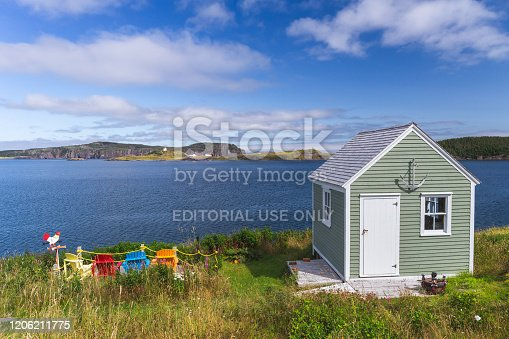Wooden colorful dechchairs in front of the lake, Newfoundland, Canada