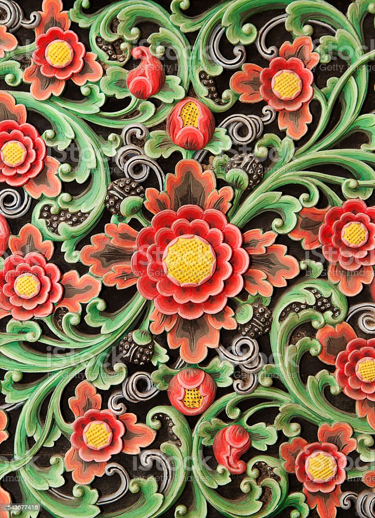 Wooden colorful floral carving decorative panel Textural background. stock photo