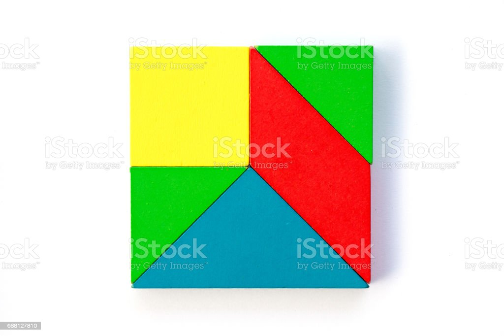 Wooden colorful toy block in multiple shape build to square design on white background stock photo