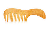 istock Wooden comb isolated 976684612