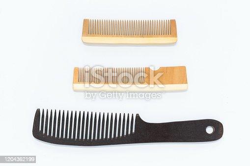 istock Wooden comb 1204362199