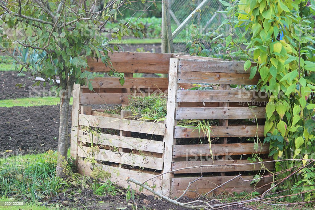Wooden compost heap, compost bin converter, allotment / vegetable garden waste stock photo