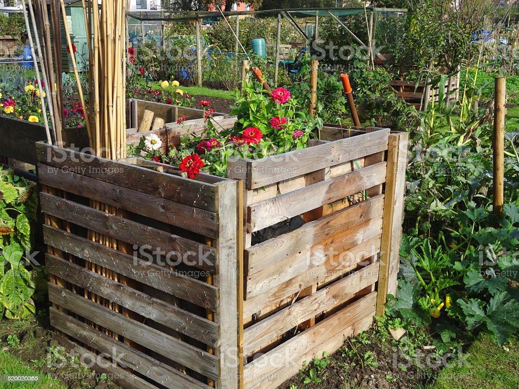 dirt formal garden front or back yard fruit garbage wooden compost heaps compost bin