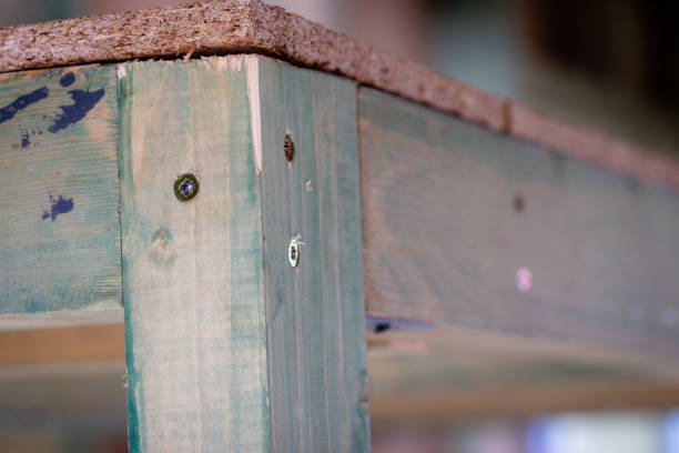 wooden construction with screwed metal angle bracket