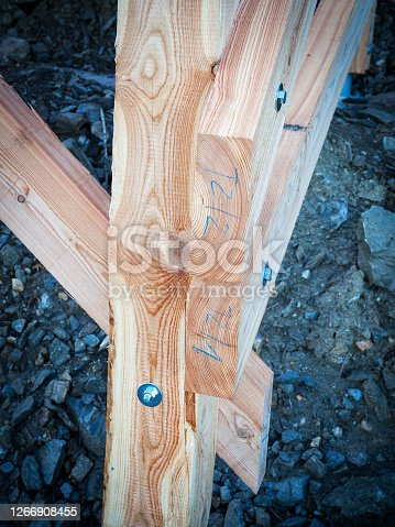 Wooden constuction material
