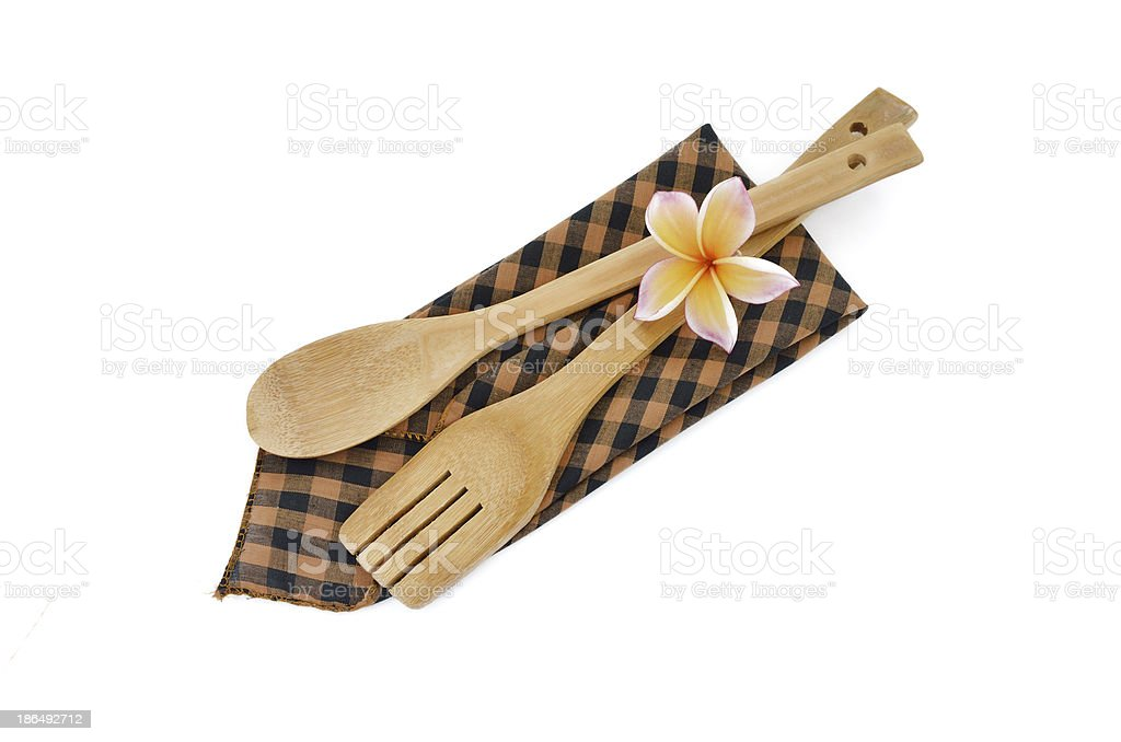 Wooden cooking utensils with checkered cloth isolated on white royalty-free stock photo