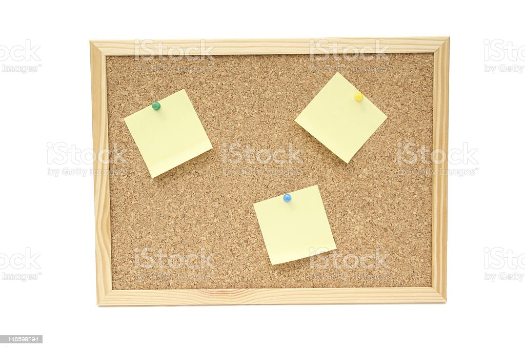 Wooden Cork Board with sticky notes stock photo