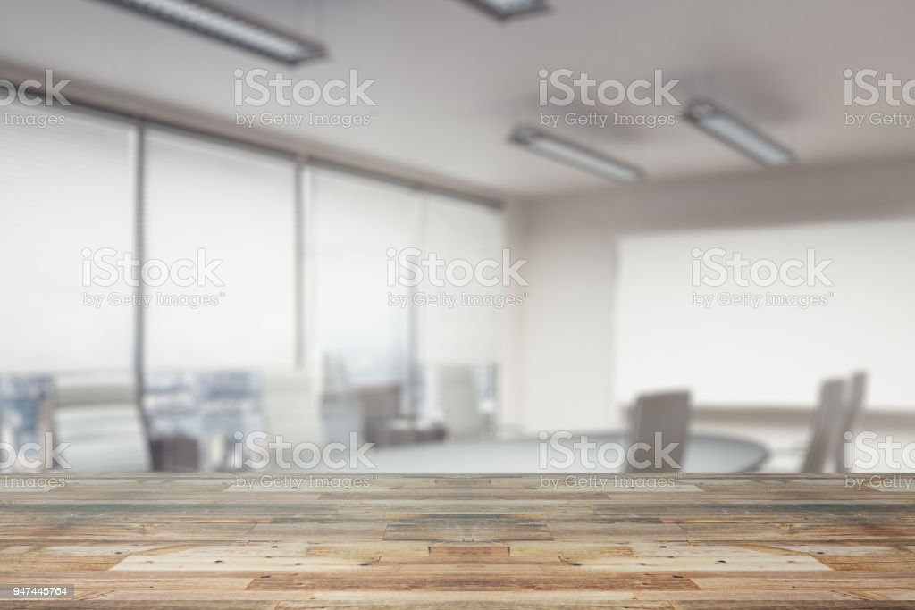 Wooden Counter On Office Wallpaper Royalty Free Stock Photo