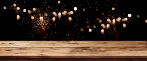 Wooden counter with firework on night sky stock photo