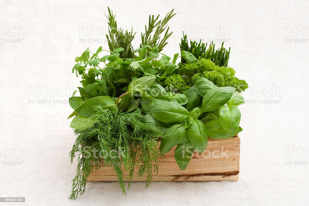 Wooden crate full of fresh herbs stock photo