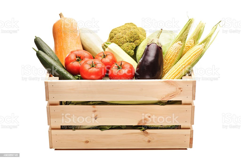 Wooden crate full of fresh vegetables stock photo