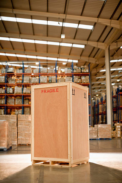 wooden crate in warehouse - fragile stock pictures, royalty-free photos & images