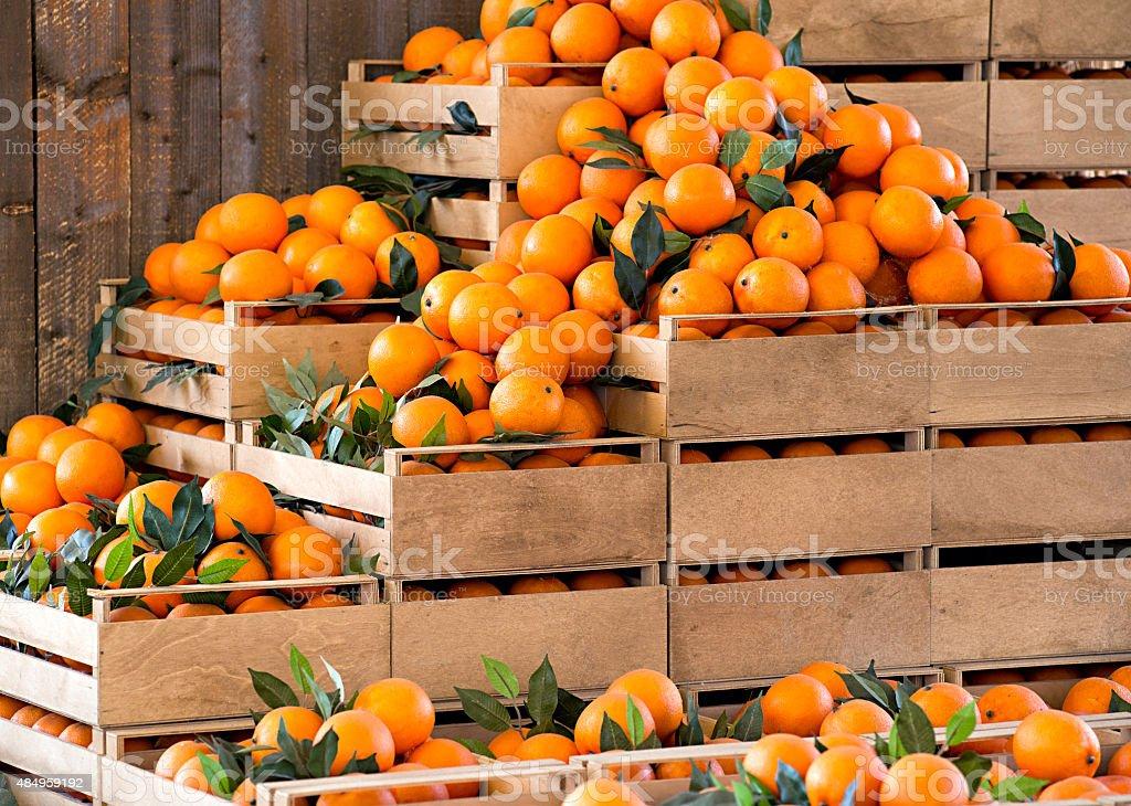Wooden crates of fresh ripe oranges stock photo