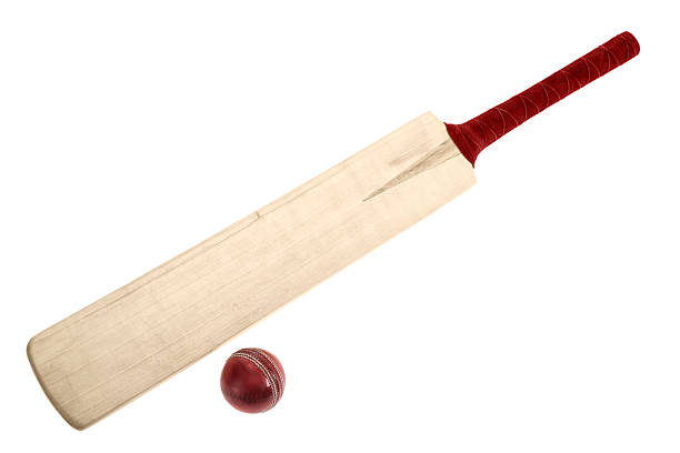 Wooden Cricket bat and ball on a white background