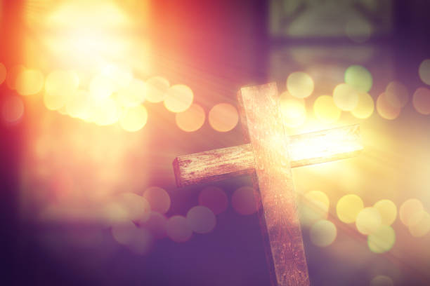 wooden cross decoreted in church under the ceremonial lighting stock photo