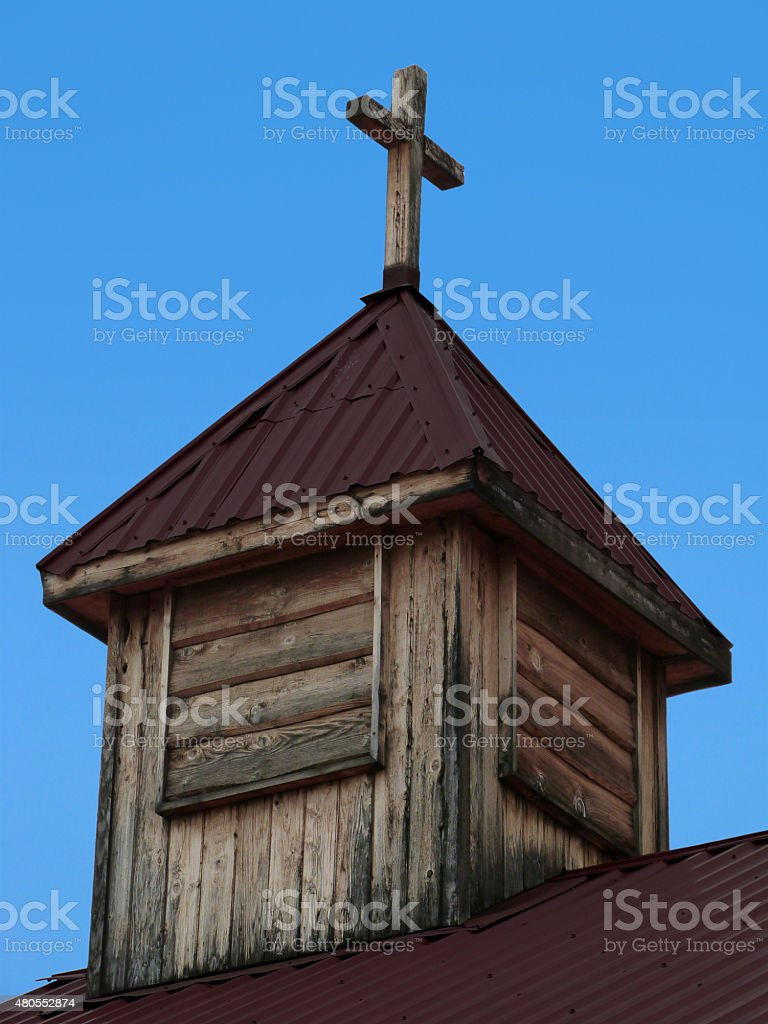 wooden cross old church tower christian religious background blue