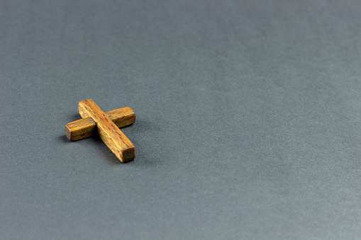 wooden cross on a dark surface