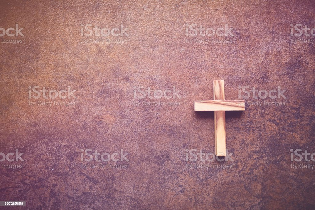 Wooden cross on dark copy space toning background stock photo