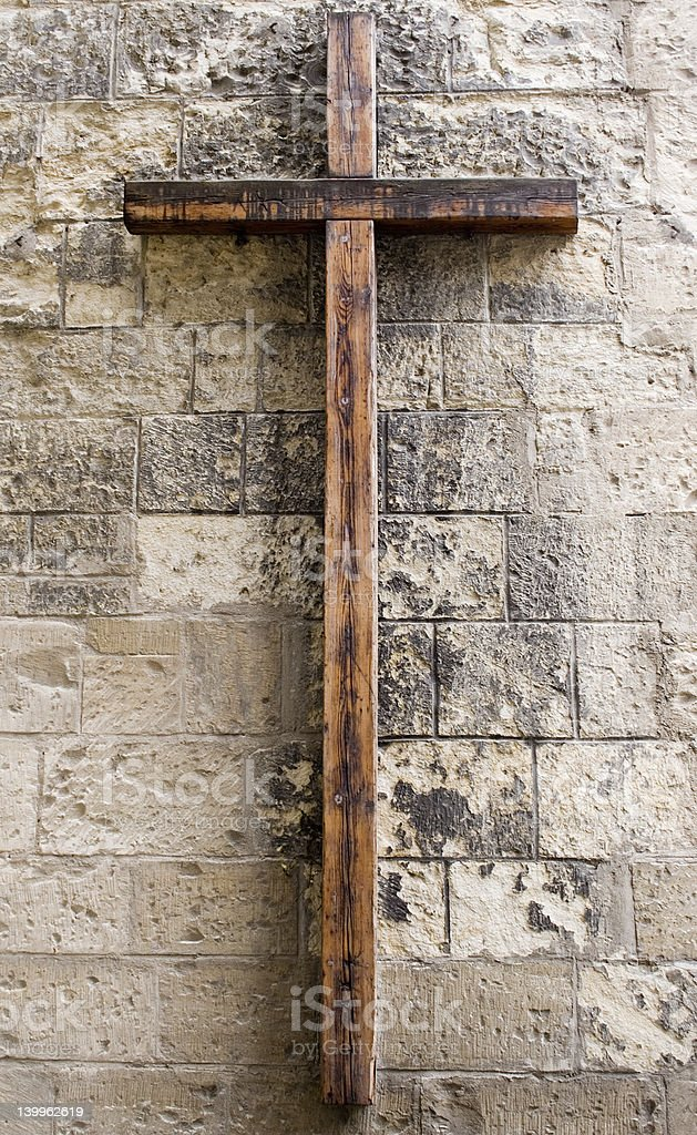 Wooden Cross on Wall royalty-free stock photo