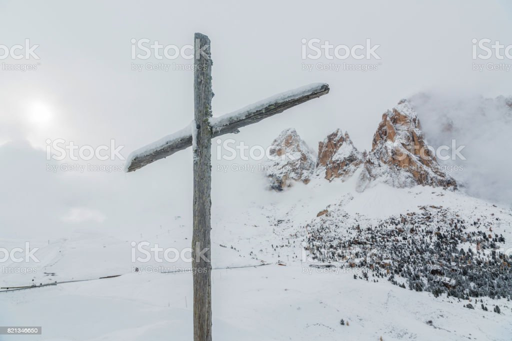 Wooden Cross with Alpspitze in Dolomites. Italy. stock photo