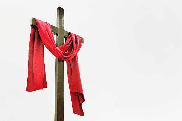 Wooden Cross with Red Cloth stock photo