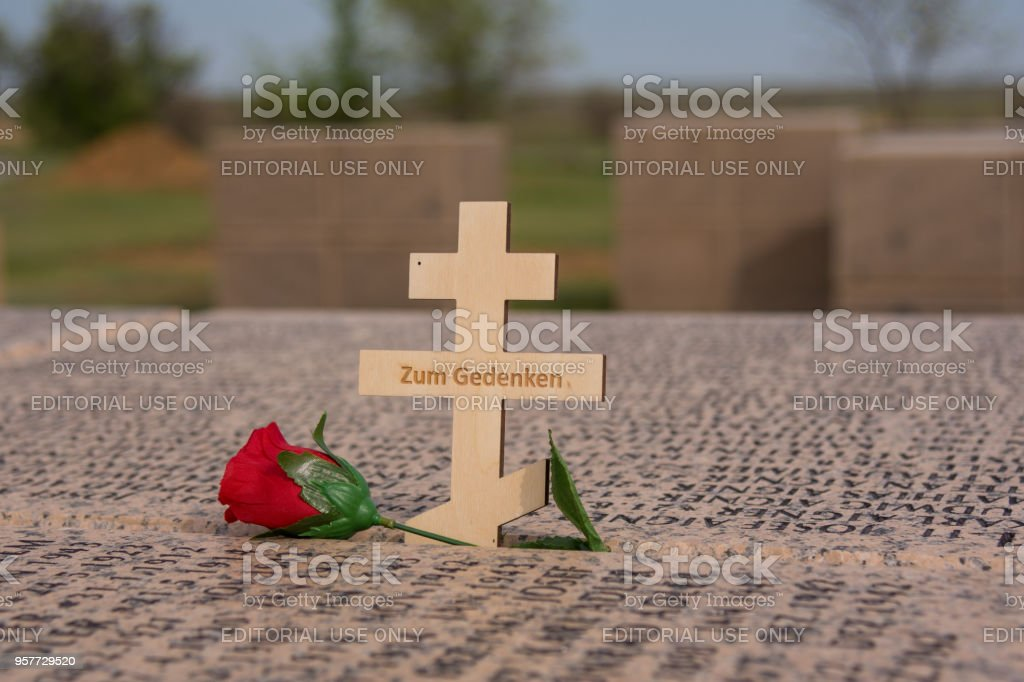 Volgograd. Russia - May 9, 2018. A wooden cross with the inscription Zum gedenken on a granite cube with the names of German soldiers who died in the Battle of Stalingrad, in the territory of the German cemetery in the village of Rossoshki, Gorodishchensk stock photo