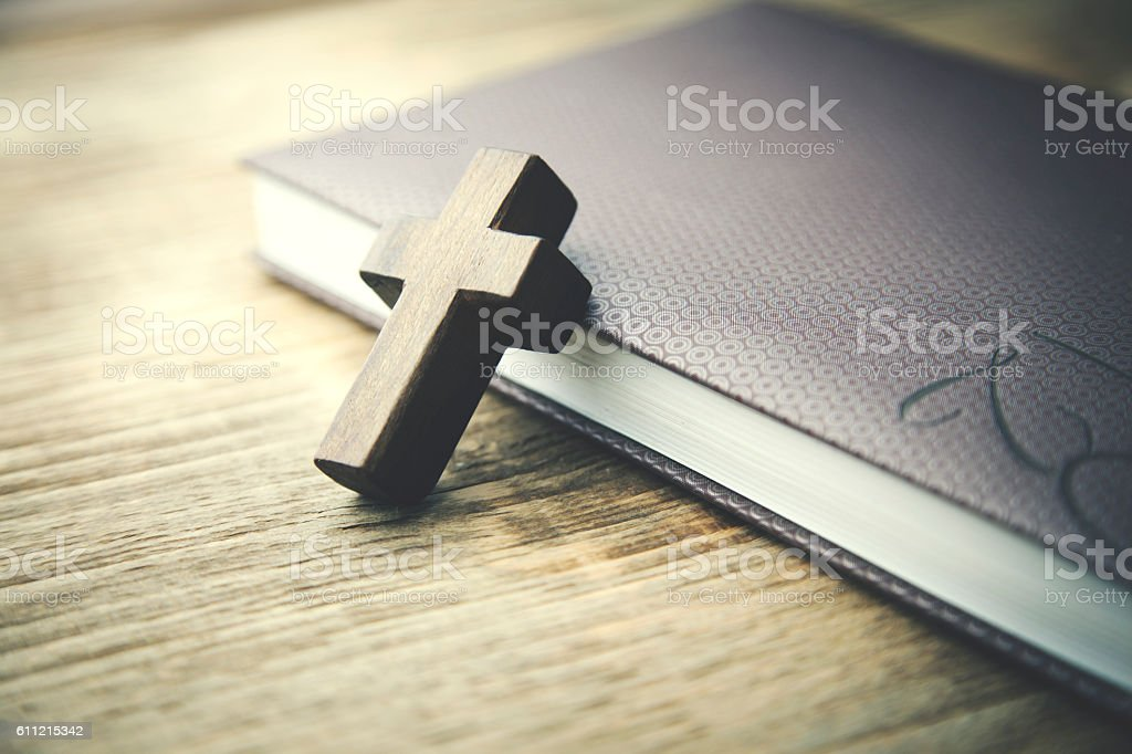 wooden crosses on book stock photo