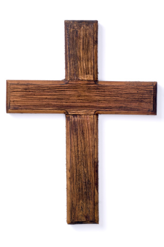 A wooden cross set on a white background. In this version, I have removed the hook and made the shadows lighter.